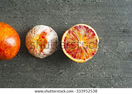 peeled blood oranges on dark wood table #333952538