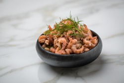 Peeled German Friesland north sea shrimps or crabs in bowl