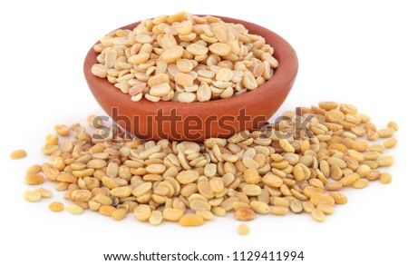 Peeled mung bean in  pottery over white background