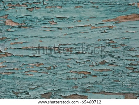 peeled paint over wood boards from a boat hull