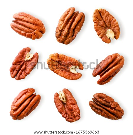 Peeled pecan nuts close-up on a white. Isolated Foto stock ©
