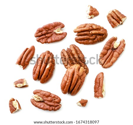 Peeled pecans with broken halves and pieces on a white background. The view from top. Foto stock ©