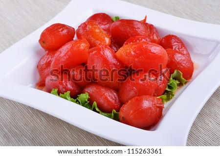 Peeled plum tomatoes on a plate