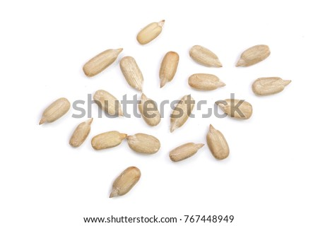 Peeled Sunflower seeds isolated on white background. Top view #767448949
