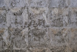 Peeling old paint on a concrete wall. Abstract background. Space for lettering or design