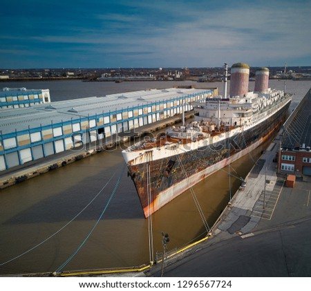 peeling paint and rust on the old and retired ocean liner which set and still holds the transatlantic crossing of the Atlantic ocean record set in 1959 shipyard awaiting restoration