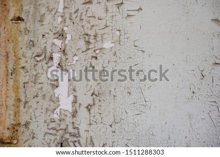 Peeling paint on a plaster wall surface. it is old walls and surfaces are deteriorating. #1511288303