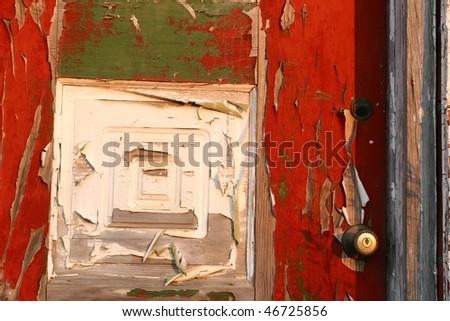 Peeling paint on an old door.