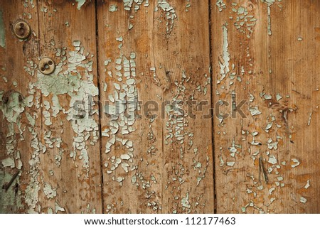 Peeling paint on an old wood wall