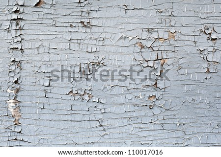 Peeling paint on an old wooden wall