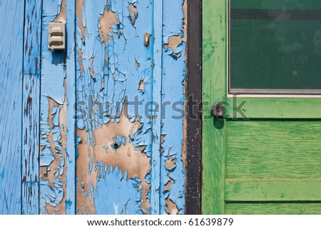 Peeling Paint On Exterior Door And Wall Of Abandoned Building In Desperate Need Of A Paint Job