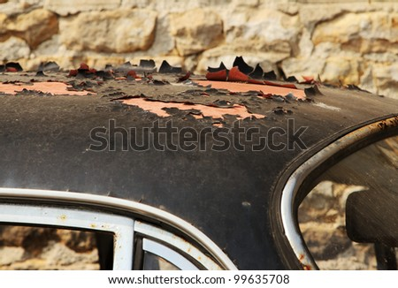 Peeling paint on old car wreck  roof