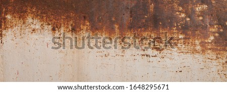 Peeling paint on the rust wall. Empty for design, pattern, cover, overlay texture, background and other, Surface of old steel background. ストックフォト ©