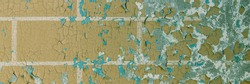 Peeling paint on the wall. Panorama of a concrete wall with old cracked flaking paint. Weathered rough painted surface with patterns of cracks and peeling. Wide panoramic texture for design background