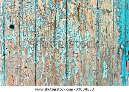 Peeling paint on weathered wood as a detailed background image