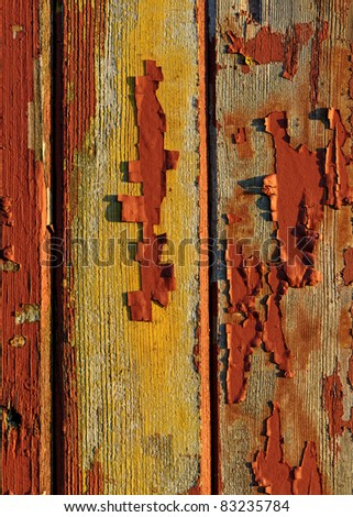 Peeling red paint on wooden boards from an old barn