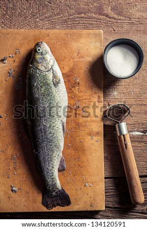 Peeling the shells of fresh fish