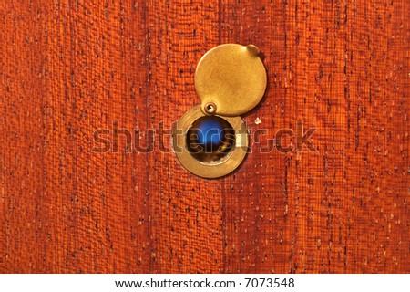 Peephole on peeling wooden door