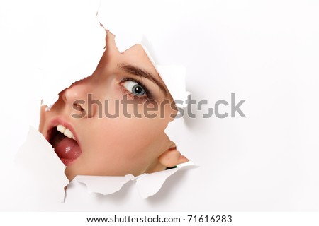 peeping teen girl surprised through hole in paper