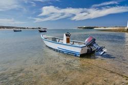 Peer and boats at Vila Nova de Milfontes, Portugal