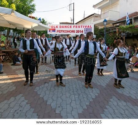 Pefkohori,Greece-May 11 2014 : Folk Dancers taking part in the Anual Folk Dance festival in the village square of Pefkohori,Greece