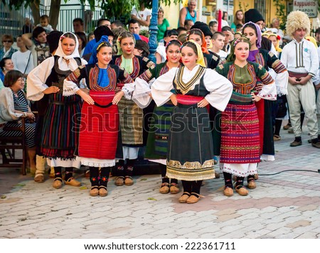 PEFKOHORI , GREECE - SEPTEMBER 19 2014 : Folk Dancers from several countries  taking part in the Annual Folk Dance festival in the village square of Pefkohori ,Greece