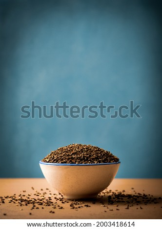Peganum seeds in a bowl with copy space. Peganum harmala, commonly called wild rue, Syrian rue or African rue. From ancient times, it has been claimed to be an important medicinal plant. Photo stock ©