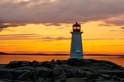 Peggy's Cove Lighthouse Tourism Tourist Attraction of Nova Scotia in Canada at Sunset