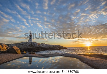 Peggy's cove lighthouse with huge rock sunset ocean view landscape in Halifax, Nova Scotia