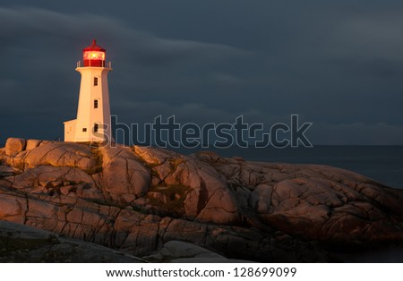 Peggys Point Lighthouse at night, Nova Scotia - stock photo