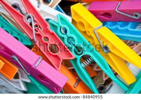 Pegs for hanging clothes to dry in the garden - stock photo