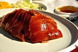 Peking duck (Beijing Roast Duck) - traditional Chinese dish.
