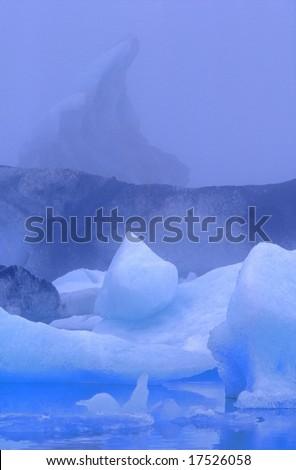Pell-mell of icebergs in blue color?s range, Jokulsarlon lagoon, Iceland