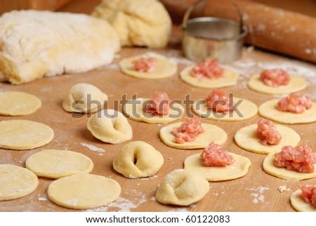 Pelmeni - traditional russian dish. Preparation, selective focus