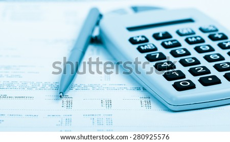 Pen And Calculator On A Paper With Graph And Charts Blue Toned EZ
