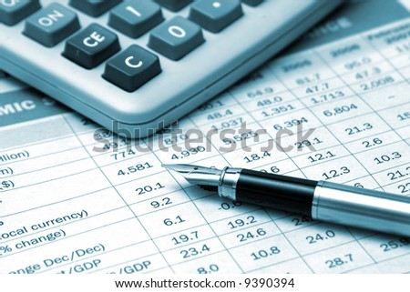 pen and calculator on the financial table