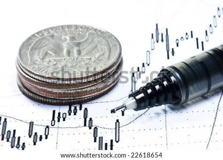pen and dollar coins on stock chart