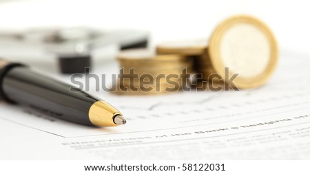 pen and euro coins