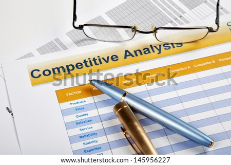 Pen and glasses on official papers - stock photo
