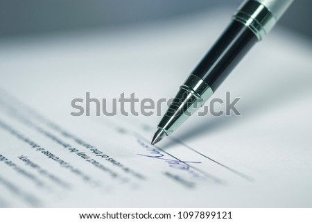 Pen and signature on paper background Selected focus