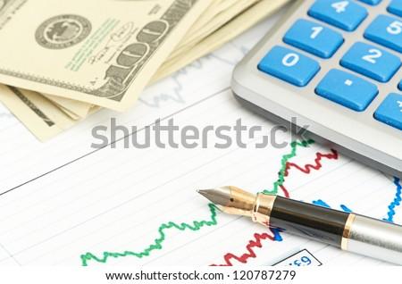 Pen, calculator and dollars