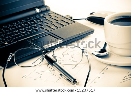 Pen, chart, notebook, eyeglasses and cup of coffee. Business still-life. - stock photo