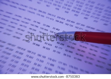 Pen checking numbers on a financial report - Blue tone and blur effect