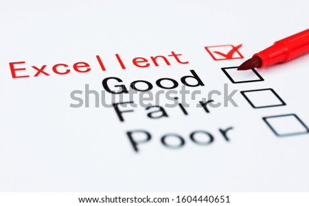 Pen checking the word Excellent in a survey