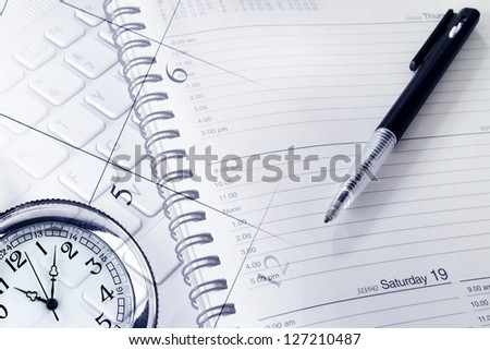 Pen, clock, diary, calendar page and keyboard