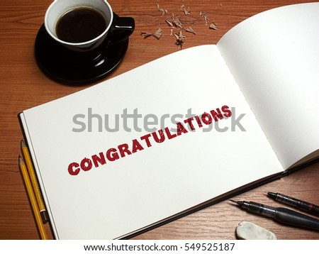 Pen, coffee and blank paper with inscription Congratulations. Realistic top view illustration. Coffee and notebook on wooden table. #549525187