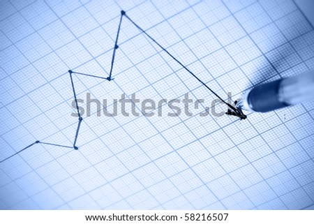 Pen drawing a crisis graph. Shallow DOF!