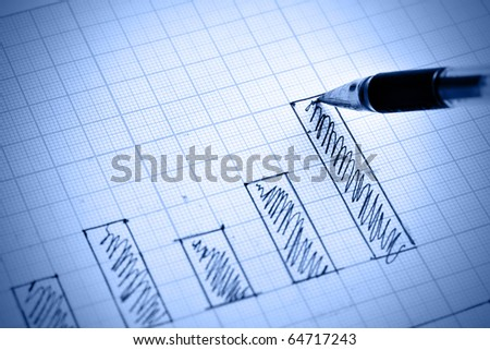 Pen drawing profit bar chart. Shallow DOF!