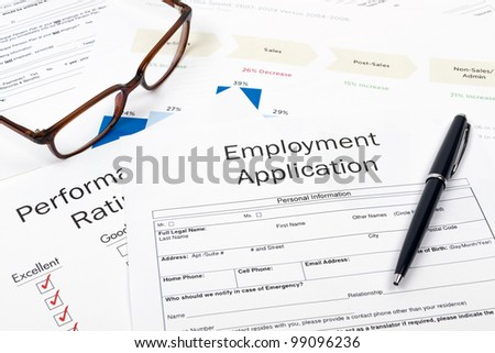 Pen, Glasses and Employment Application Form on desktop in business office.