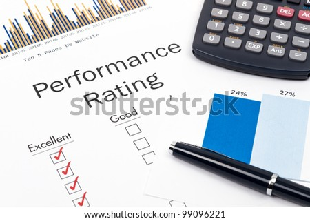Pen, Glasses and Performance Rating Form on desktop in business office.